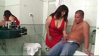 Big boobs mother in law helps him cum in the bathroom